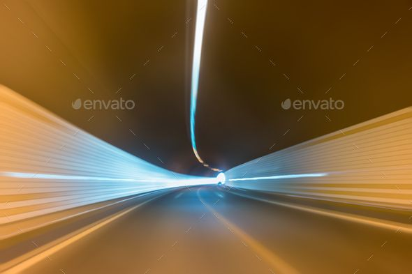 cucurve tunnel inside by chuyu2014 curve tunnel inside and road exit to light with car driving motion blur