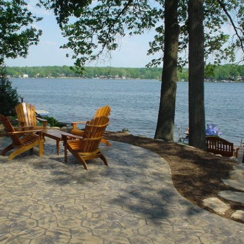 Beautiful lakefront patio in Michigan by Todd's Services ... on Lakefront Patio Ideas id=30730