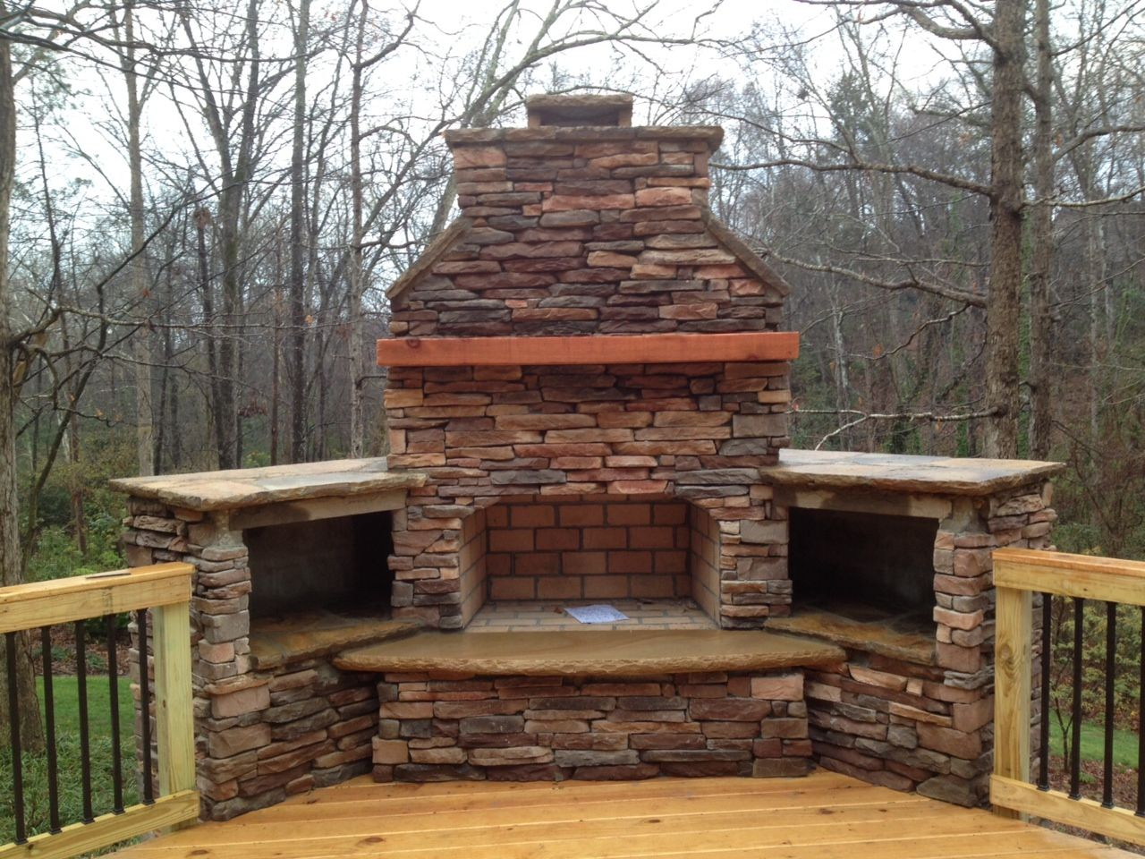 Outdoor fireplace on wood deck with deckorator balusters Deck fireplace designs