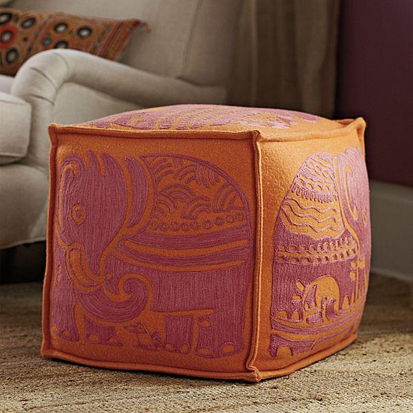 A pink and orange elephant pouf!