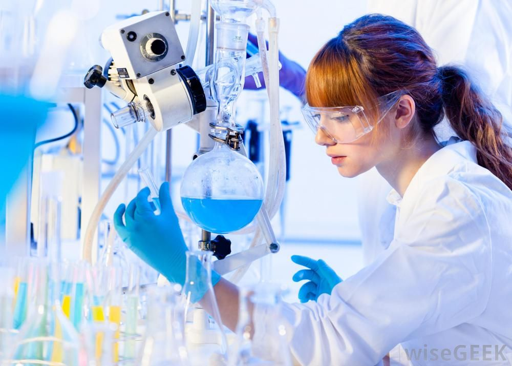 red-haired-woman-in-lab-coat-and-blue-gloves-with-beakers-and ...