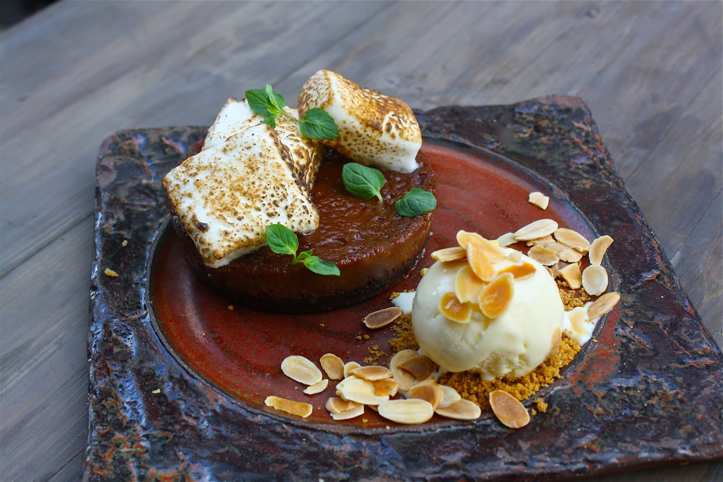 Milk Chocolate S'mores Tart served with toasted almond ice cream.