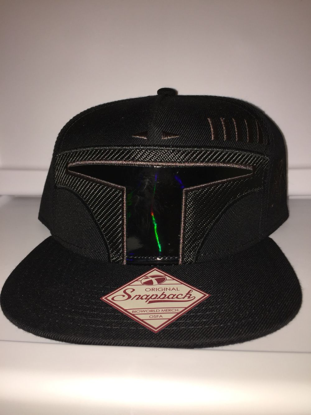3a603e7945c Bioworld SnapBack Star Wars warriors of Mandalore boba fett helmet all  black with brown stitching and boba fett symbol on the side