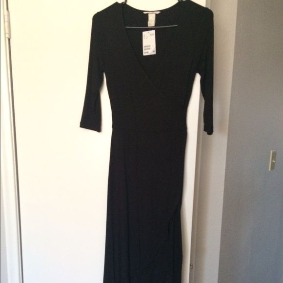 Black dress H&M Brand new black dress from H&M. Mid length, front hits above the knee and the back is just below the knee. Thin breathable material. Has a wrap around style. You can dress it up or wear it casual. H&M Dresses
