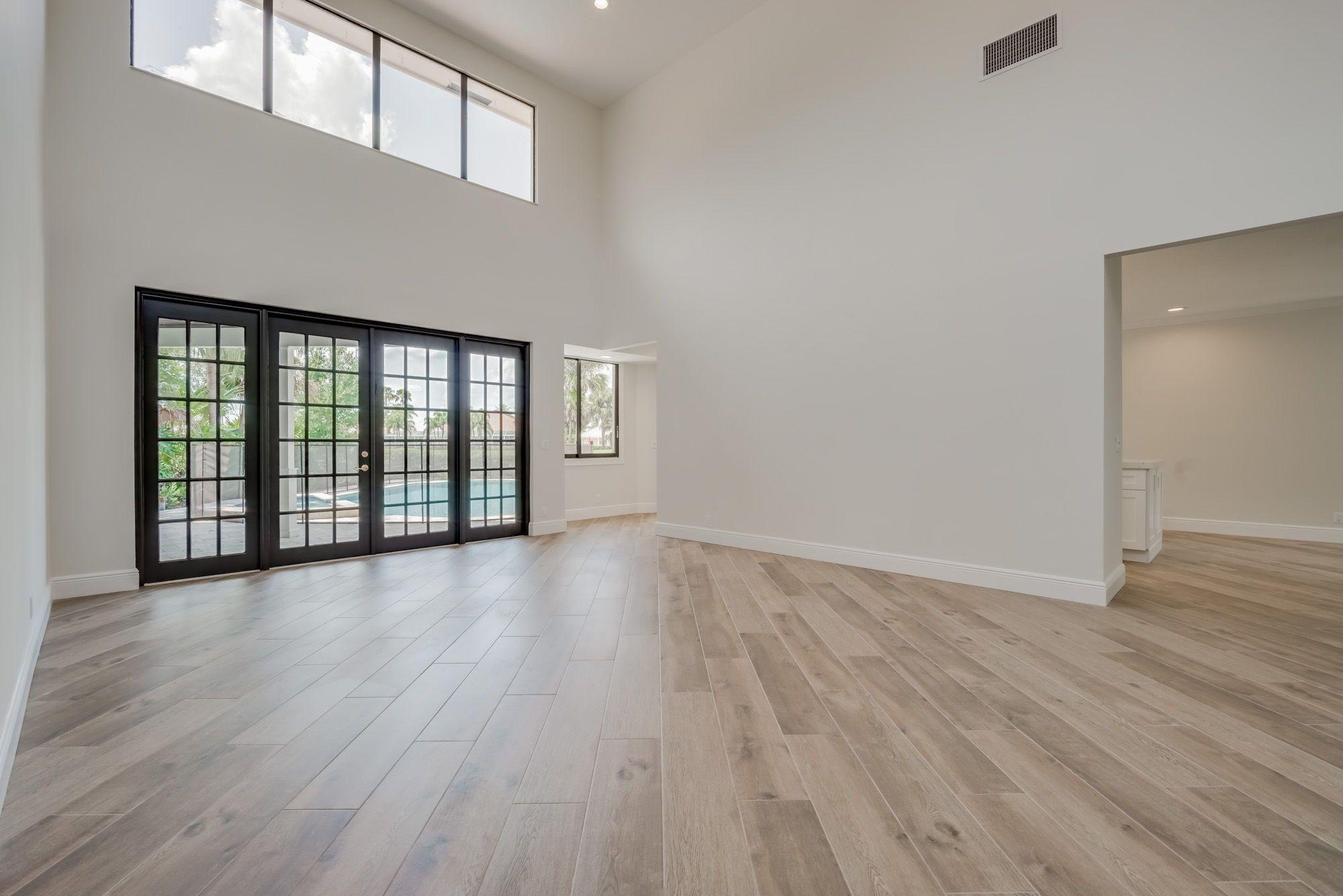 The Living Room Has Soaring 22 Ceilings Massive Clerestory Windows Wide Plank Wood Look Porcelain Wide Plank Hardwood Floors Living Room Designs Great Rooms