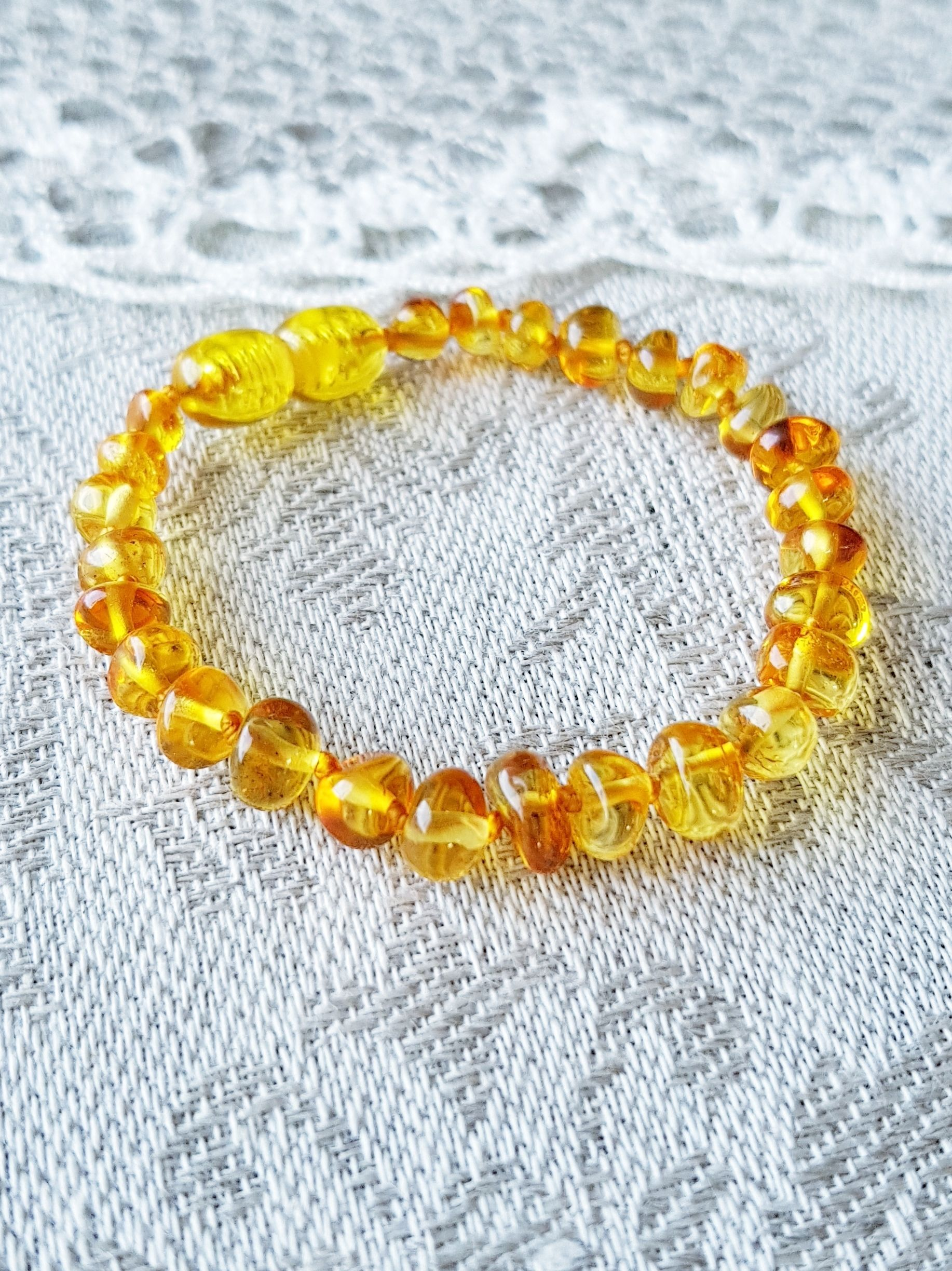 Yellow baltic amber baby teething bracelet for toddler girl and boy