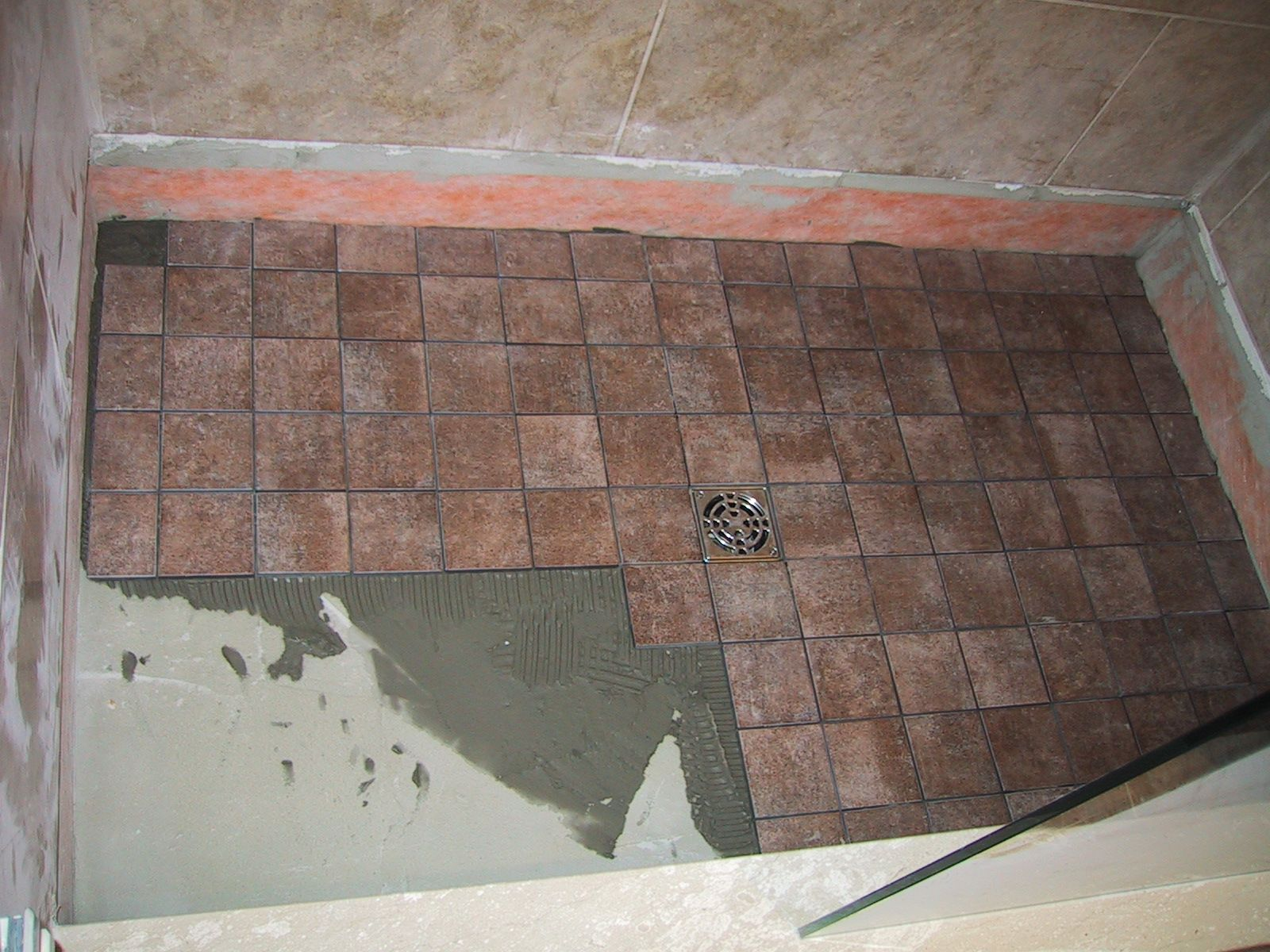 Build the shower floor first including the floor tile for Tile shower floor ideas