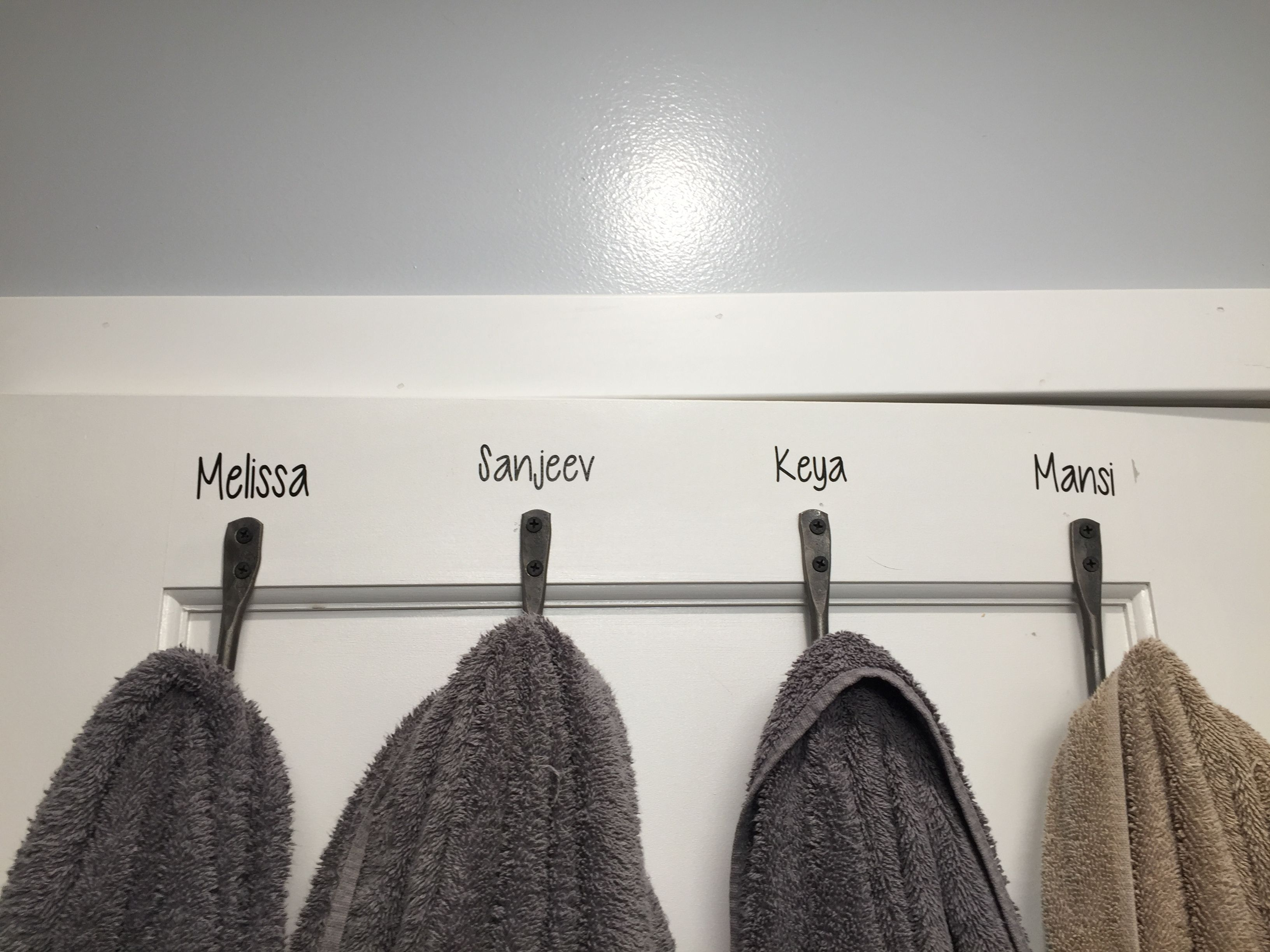 Away To Be Little More Organized In The Bathroom Label The Towel Hooks On The Back Of The Door Indian In The Cupboard Hooks For Towels Cupboard
