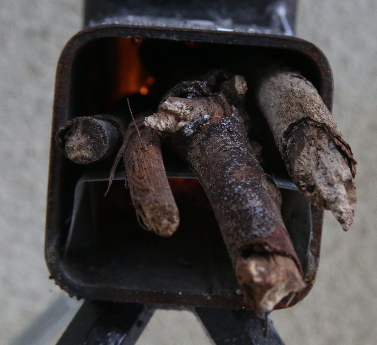 This stove had directions that said use pencil thick sticks. I used a few sizes that fit.