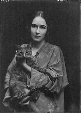 Miss Mona Bruns with Buzzer the Cat. By Arnold Genthe. Circa 1918.