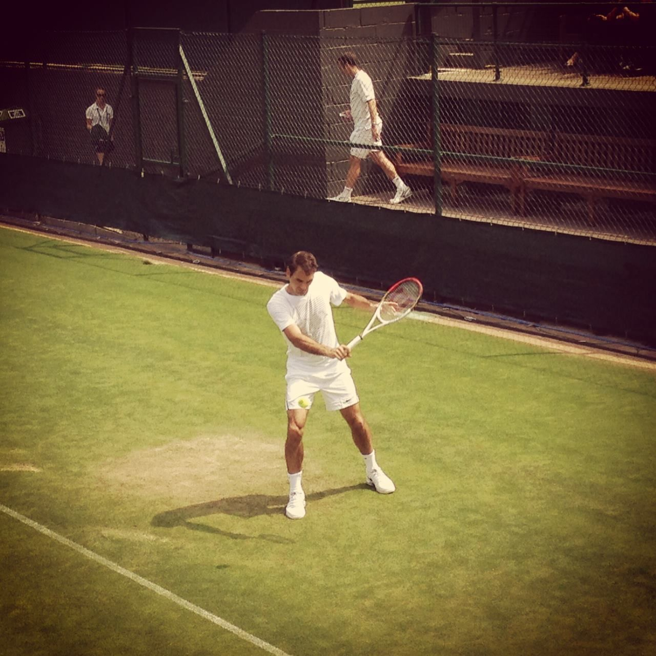 June 19, 2013:  The sun is shining at Wimbledon today and Roger Federer is out having a hit. In other words, it's a good day.