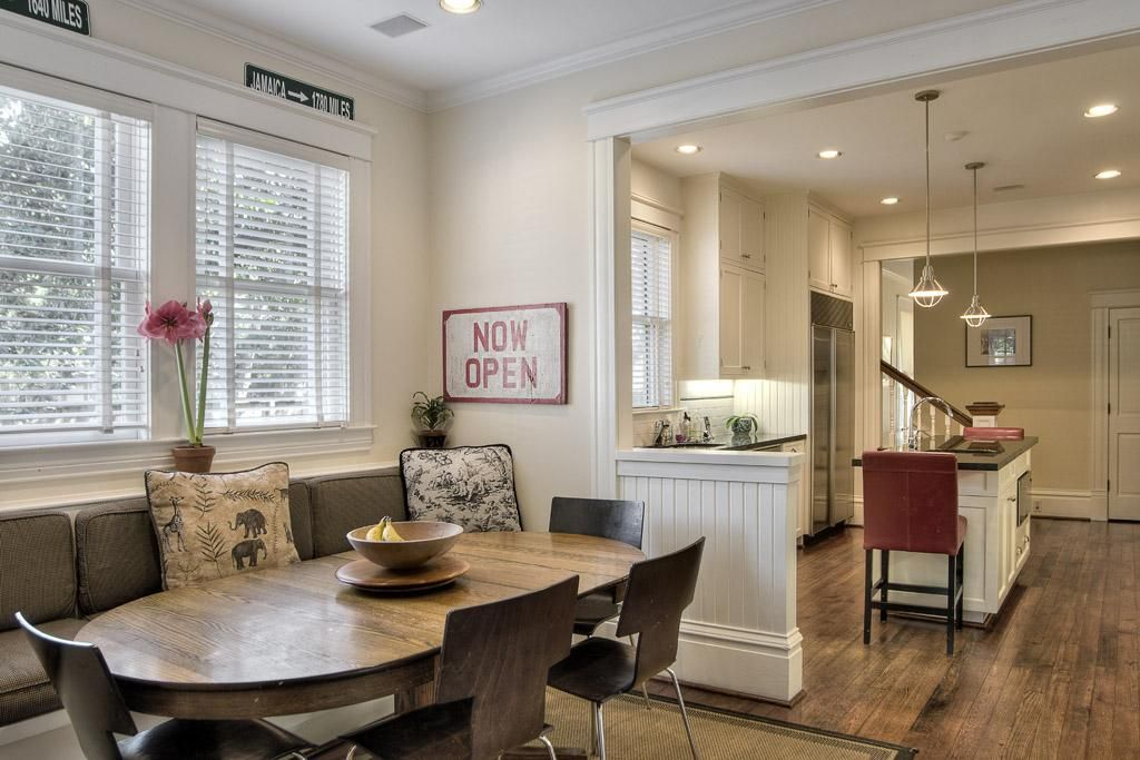 Welcoming Dutch Colonial Home In Texas Open Kitchen Nook With Pony Wall And Banquette