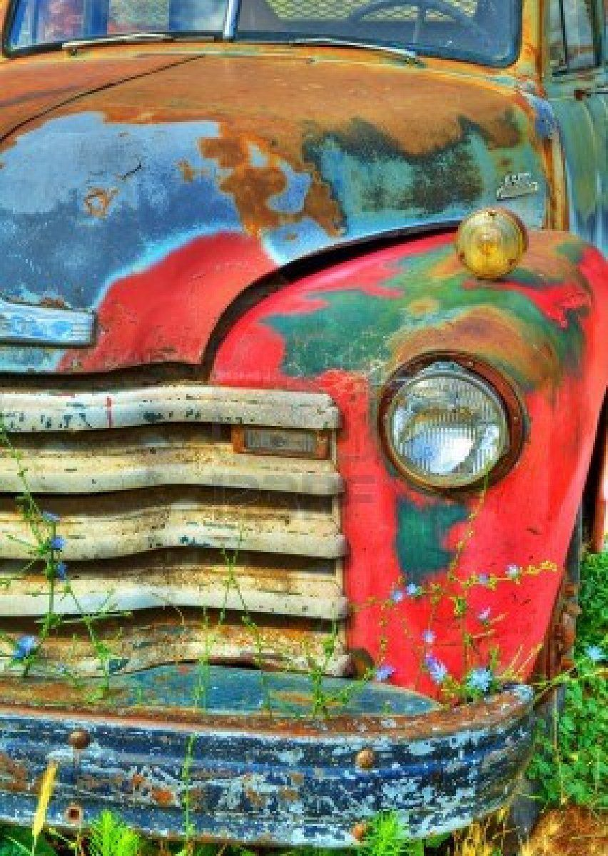 Detail of the front end of an old rusted abandoned vintage truck
