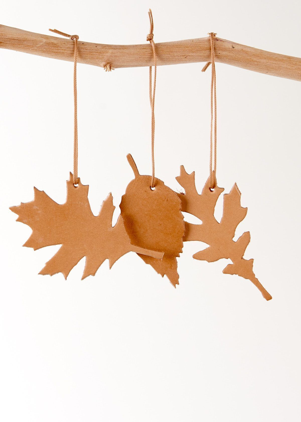handmade christmas ornaments made as leafs in nature leather