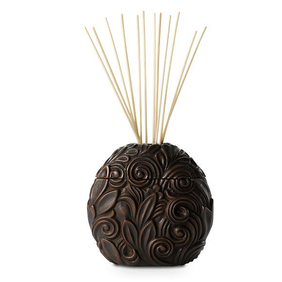 Inside A Tiny Florida Cottage Full Of Tropical Colors: PARTYLITE Diffuser Holder-$8 At: Www.partylite.biz