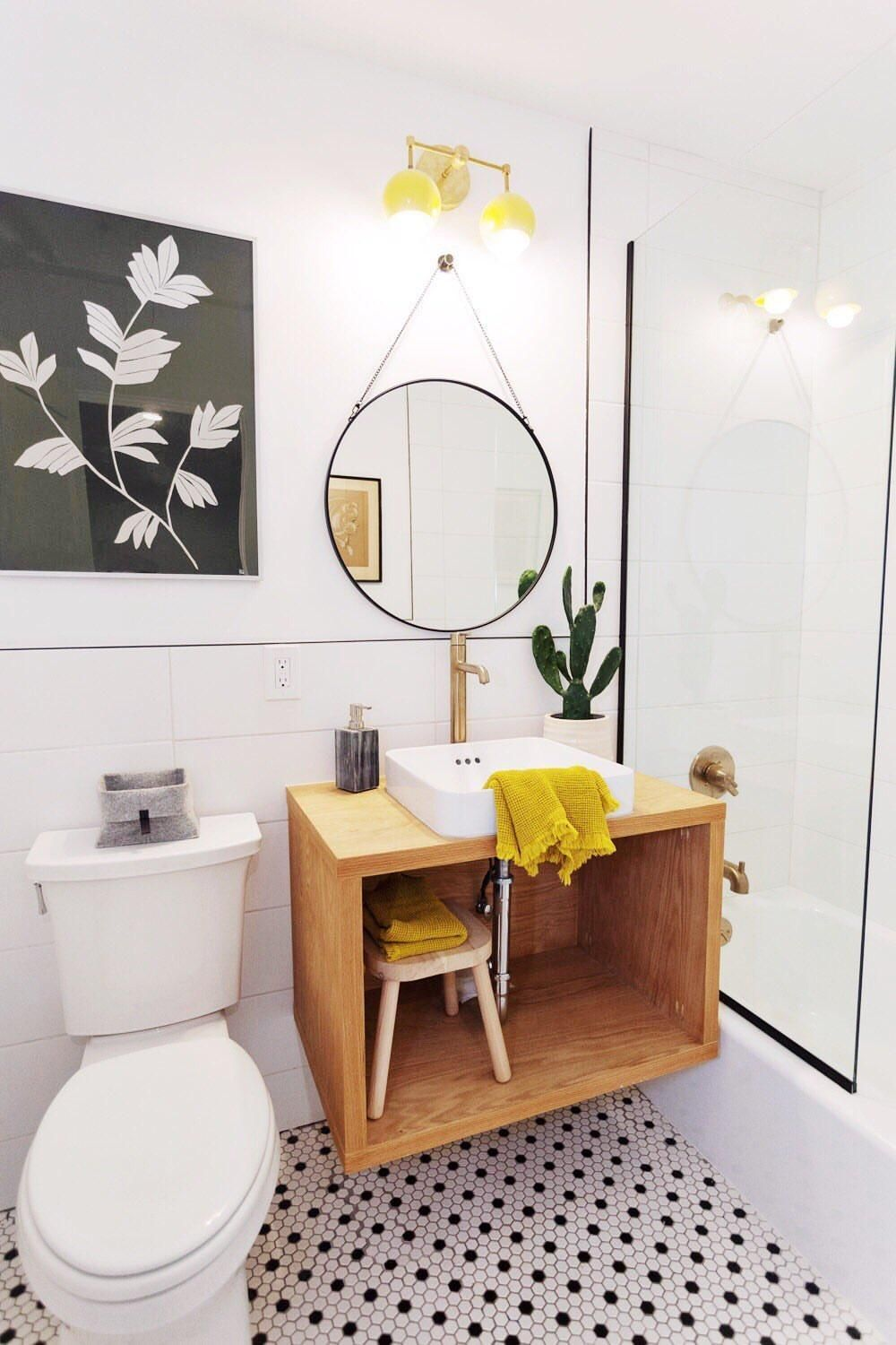 Photo of Mid Century modern bathroom renovation with yellow accents