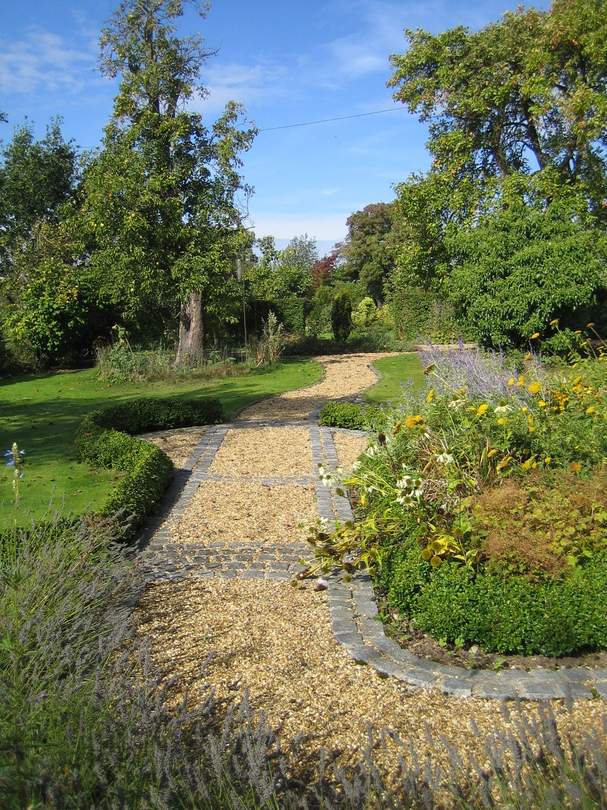 granite setts edge this gravel country garden path from a front