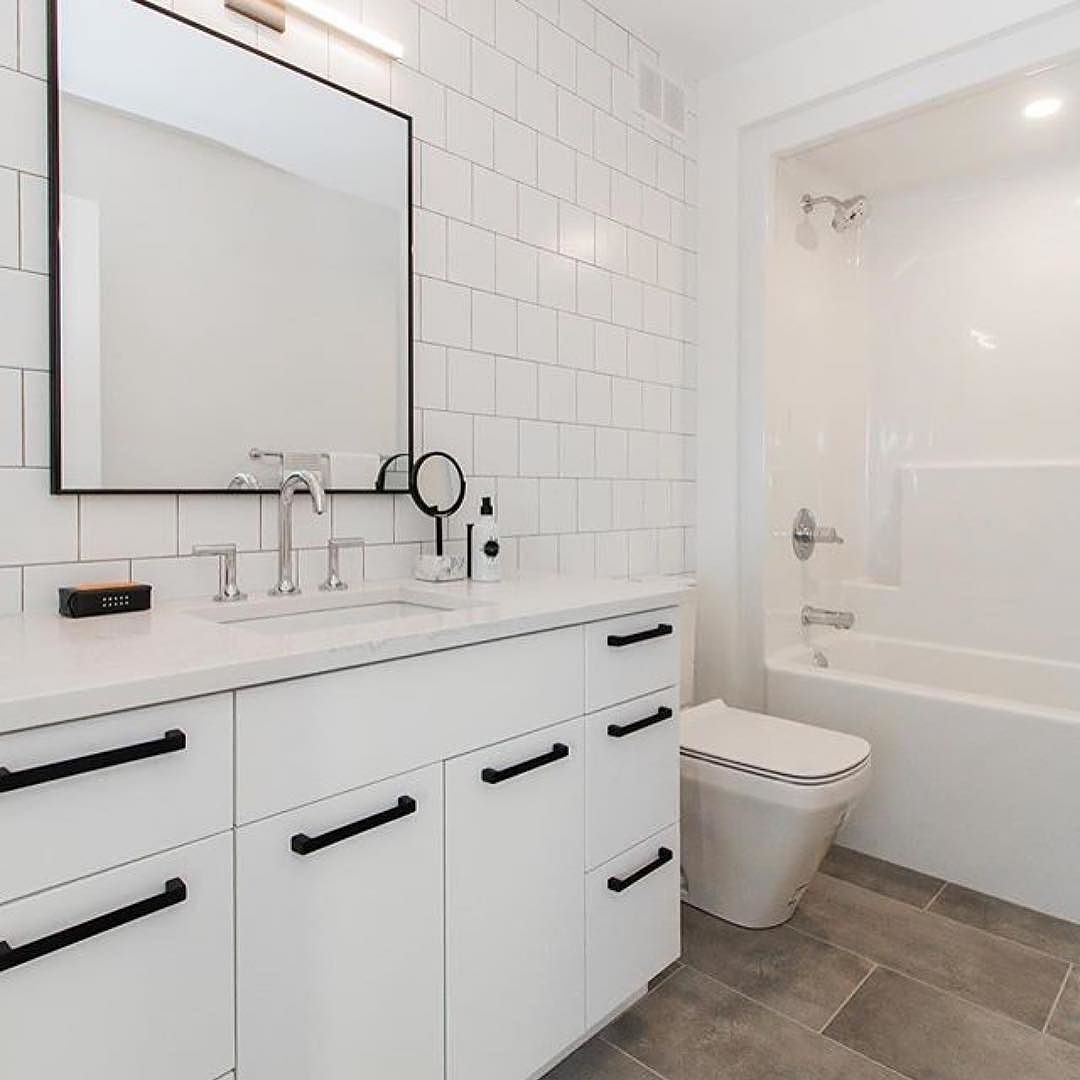 Love The Use Of Oversized Cabinet Pulls In This Stunning Blackandwhite Bathroom Remodel From Paragondesignbuild