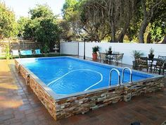 Above ground pool with stacked stone facade