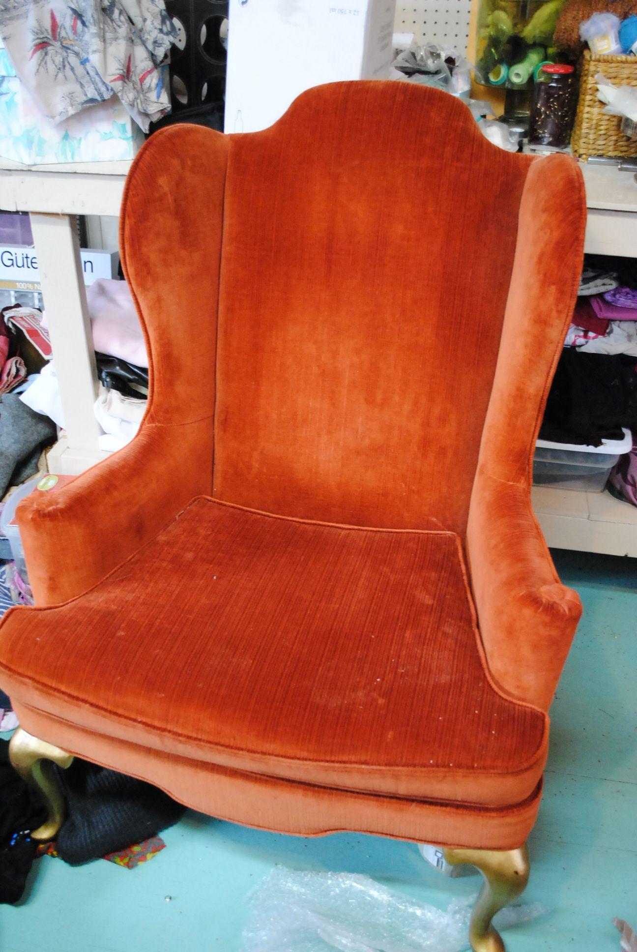 Lounge orange velvet wingback chair