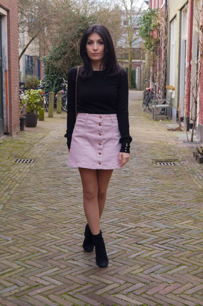 905350b114 Pink button-front denim mini skirt, black top with pearl in sleeves, suede  black boots