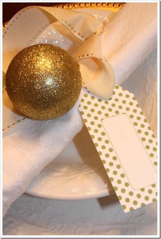 Ornament tied with ribbon, gift tag used as place card