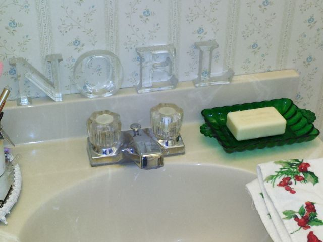 Perfectly sized ledge above the sink to hold Noel.