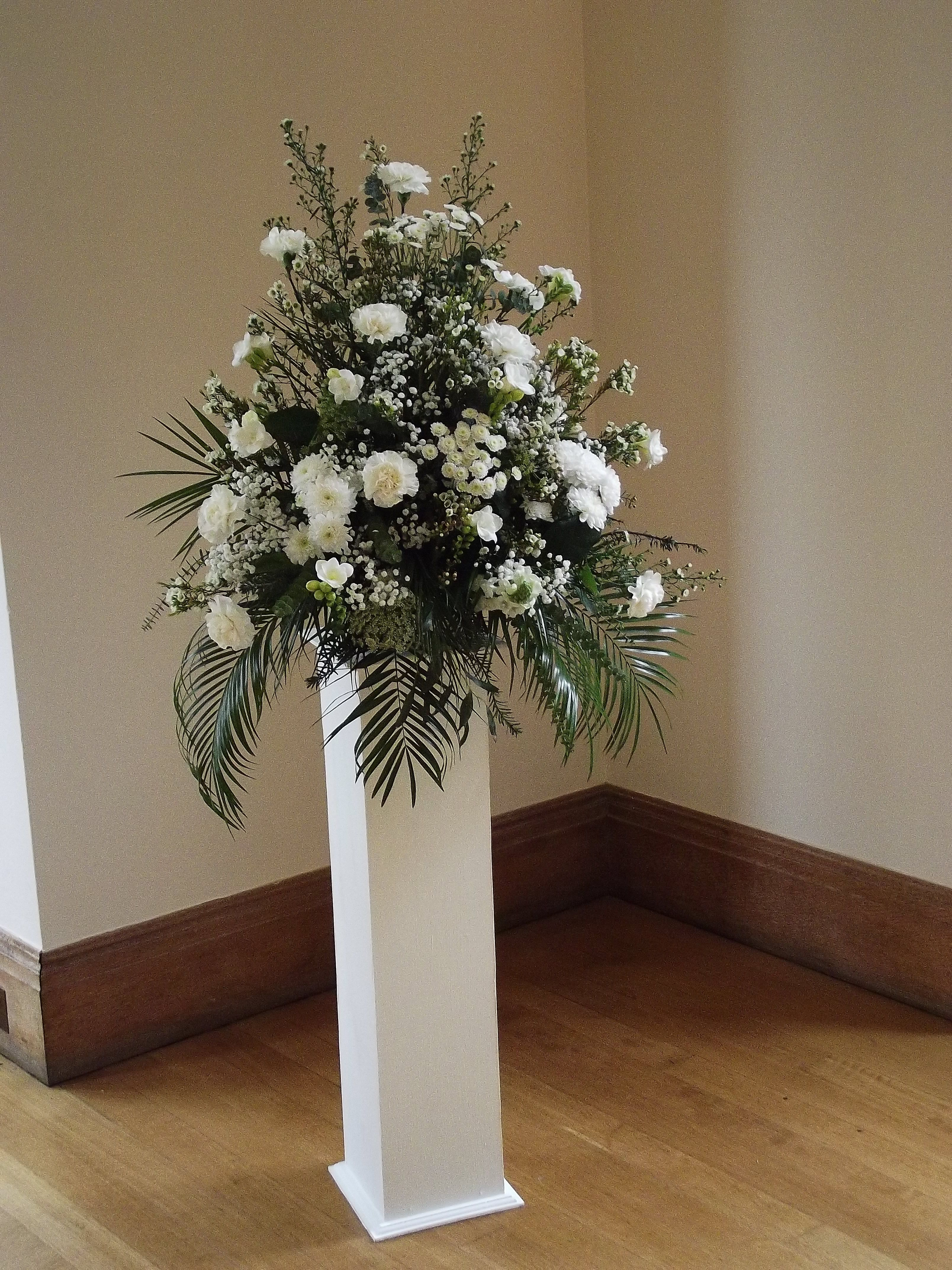 Classic plinth styling with a traditional theme floral arrangement n classic plinth styling with a traditional theme floral arrangement n ivory and white church wedding flowers izmirmasajfo