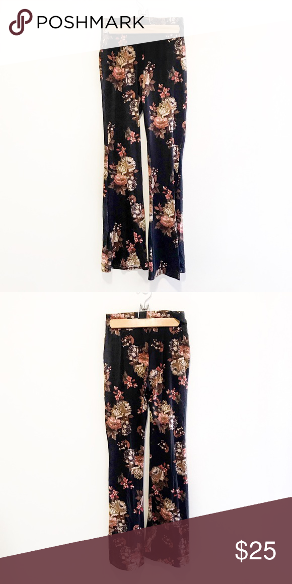 340b472662fbe1 NWOT Floral Flare Pants Wide legged and high waisted cotton flare pants  with a floral print. Only worn once. No brand