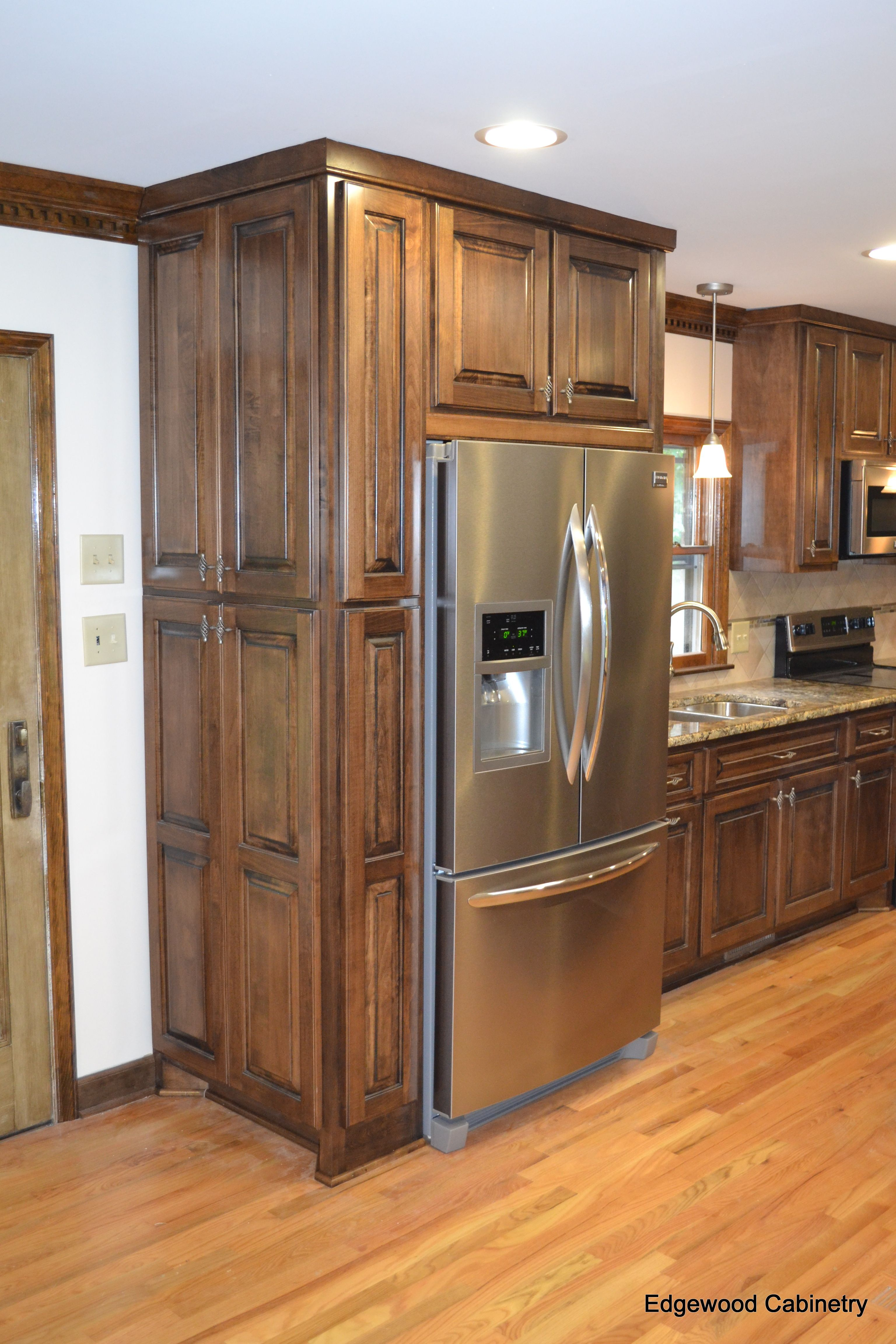 Custom maple cabinets finished in a walnut stain and then for Black stained cabinets