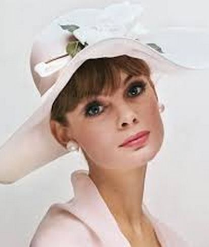 Miss Jean Shrimpton shows the perfect hat for a summer wedding, photo by William Helburn.