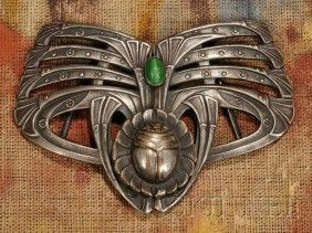 Art Nouveau Scarab and Papyrus Belt Buckle Silvered metal and hardstone Late19th/early 20th century Two-part buckle in the form of a scarab centered on an open blossom surrounded by stalks of papyrus, with oval green hardstone cabochon, 2 3/4 x 3 1/2 in.