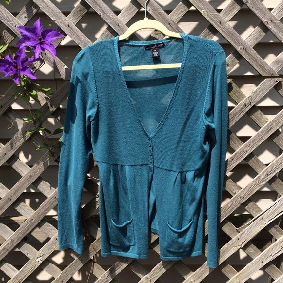 Teal cardigan with peplum size M This is a teal cardigan with a little bit of a peplum. 80% viscose 20% nylon. It's used, no holes, stains or fraying seams. It does have 2 small snags in the back that are hardly noticeable. Willi Smith Sweaters Cardigans