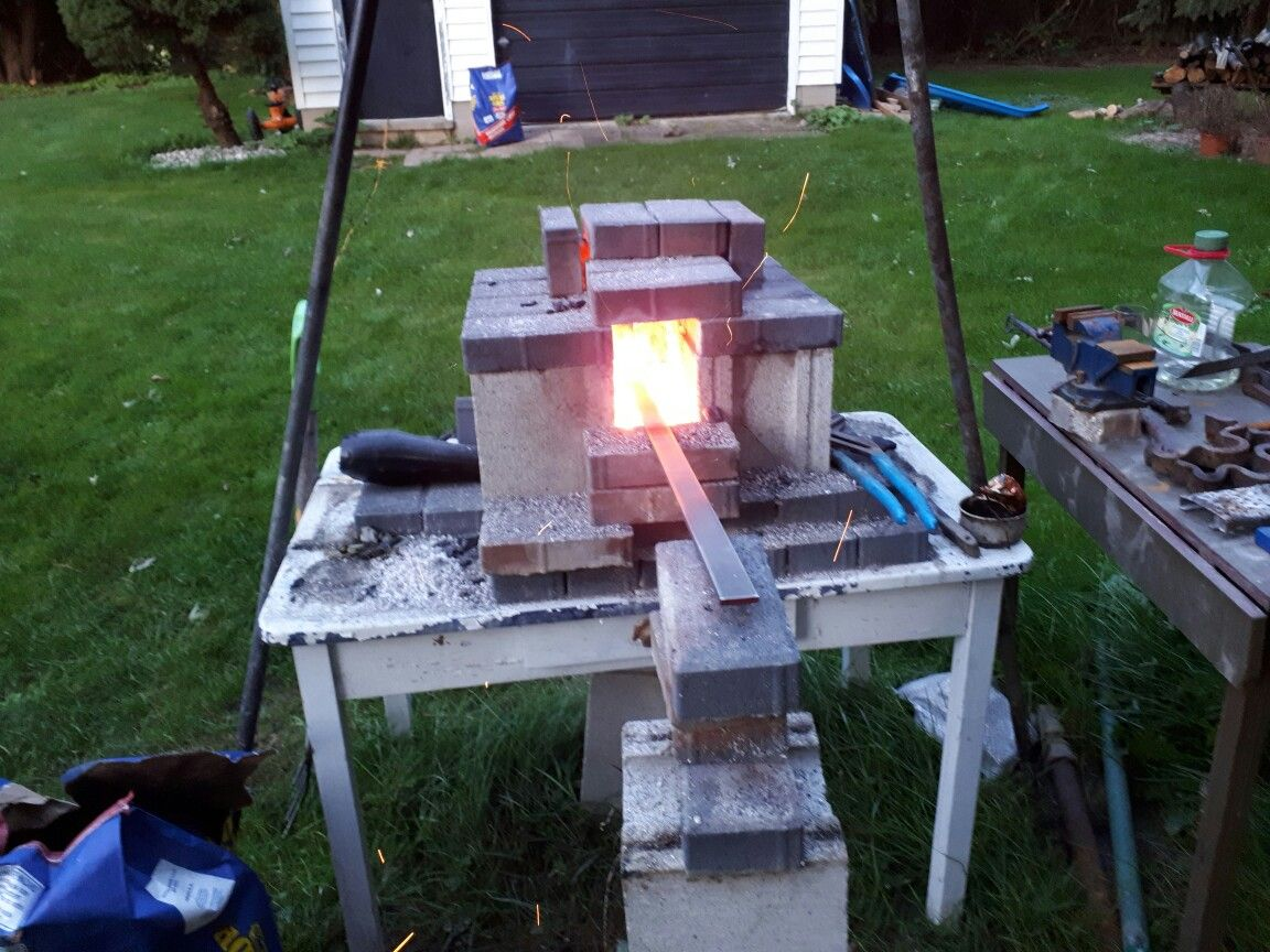 homemade backyard forge with a couple of cinder blocks and