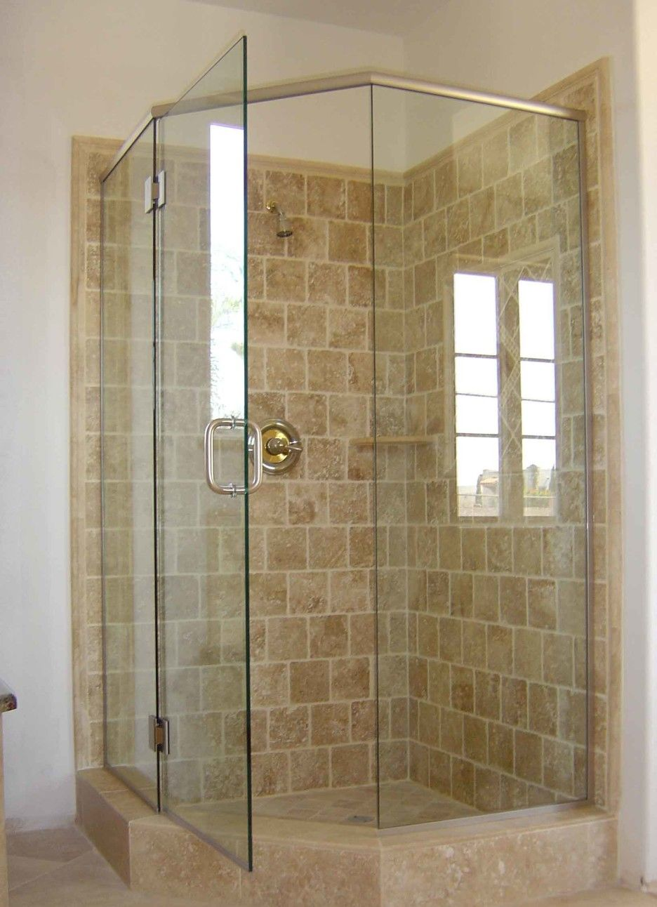Bathroom. curved shape glass shower stall with metal door handle and ...