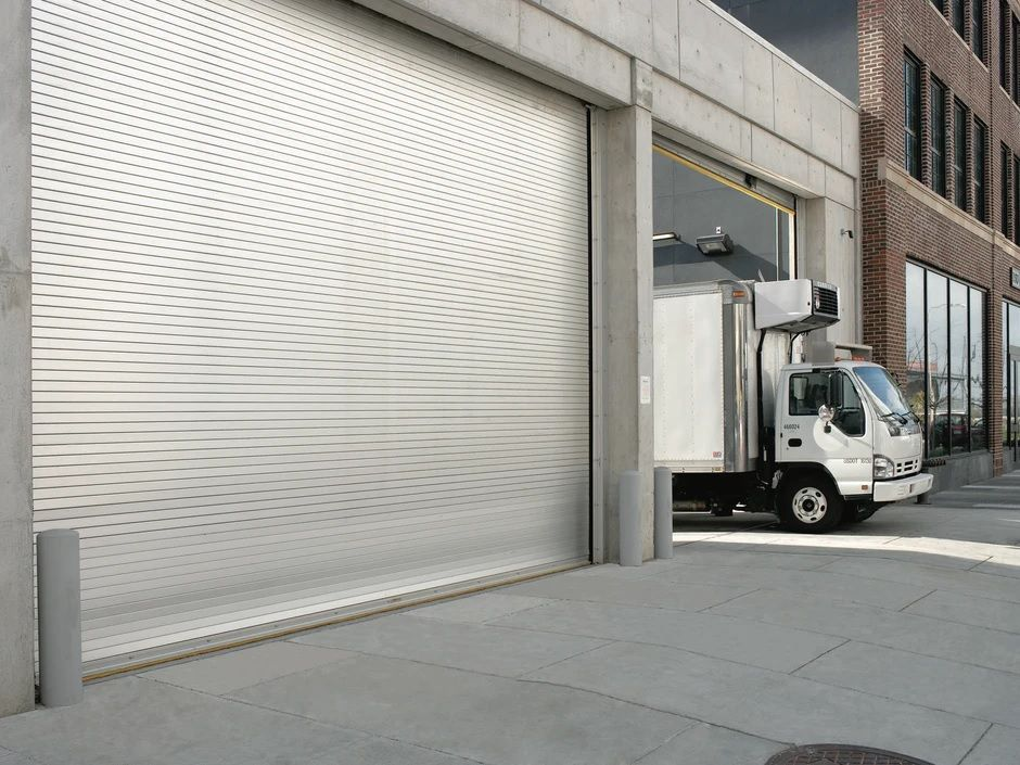 Our Roller Doors Provide The Most Cost Friendly Means Of Giving A High Level Of Security At Action Automa Rolling Steel Doors Steel Doors Garage Doors For Sale