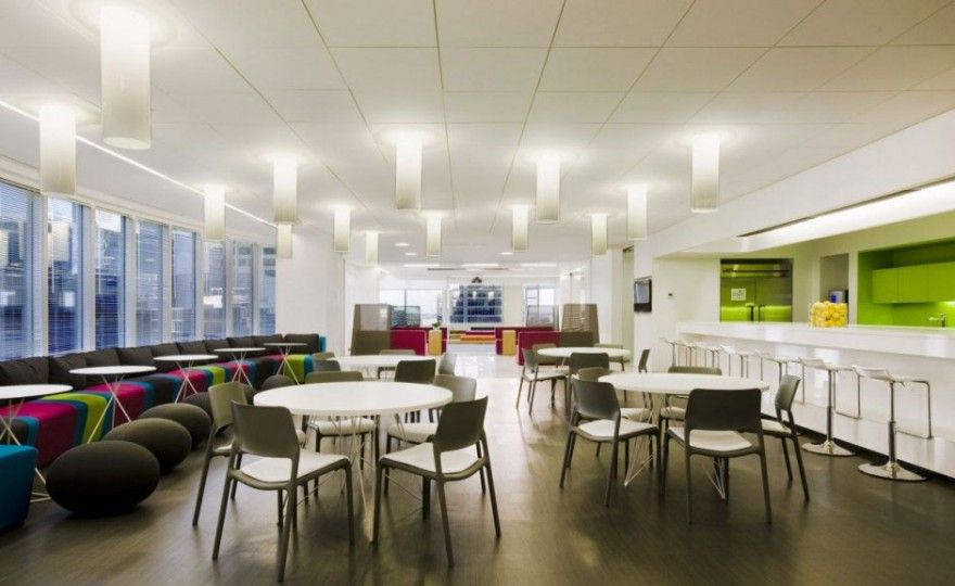 Cozy Office Canteen With Chairs Sofas Puffs Round Table And