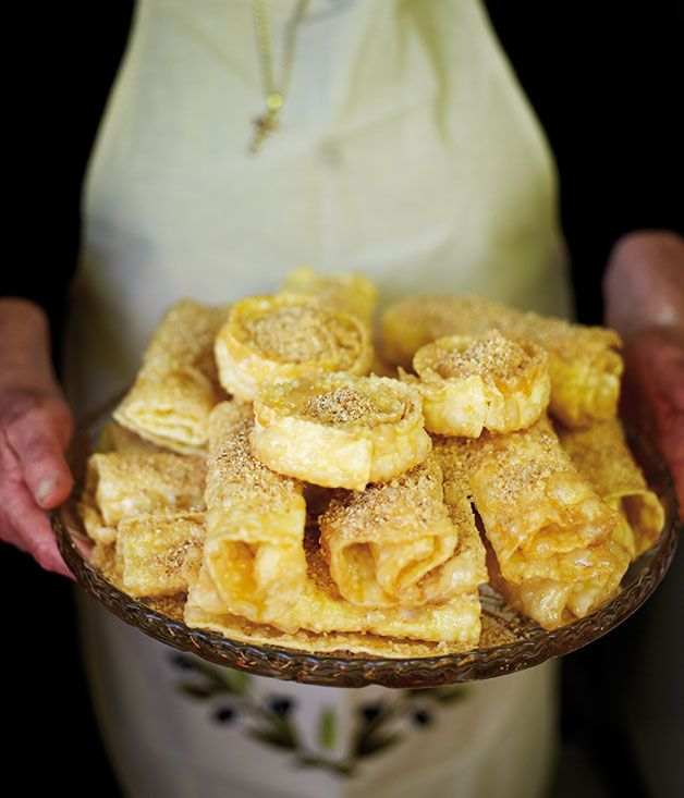 Diples - Greece [Diples are wafer-thin pieces of dough fried in hot oil, drizzled liberally with honey and sprinkled with toasted sesame seeds or cinnamon and nuts. ]