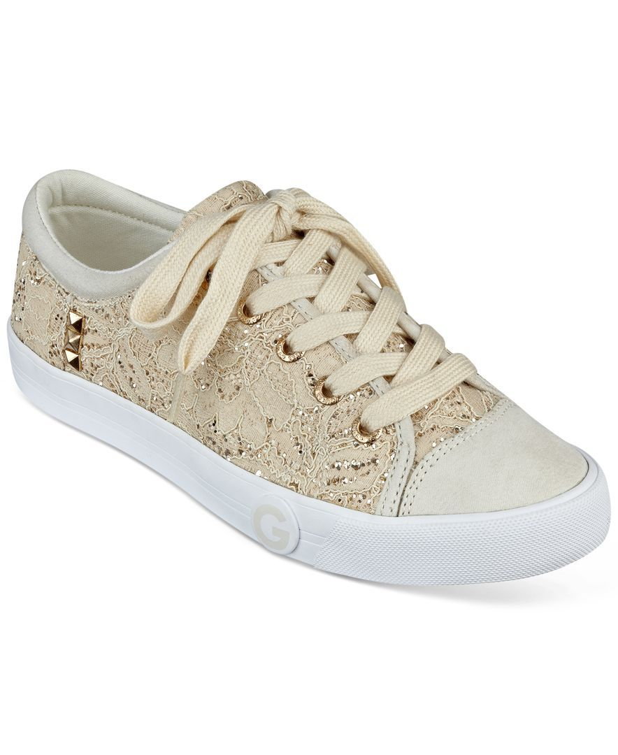 442f4ab316a7 The Oona sneakers from G by Guess are crafted in a soft fabric with pyramid  studs at the side.