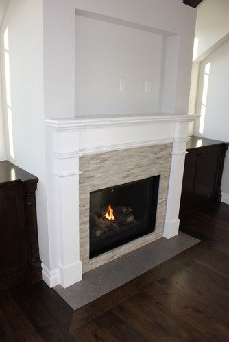 White Fireplace Surround With Tan Tile Small Basement Remodel Basement Remodeling Freestanding Fireplace