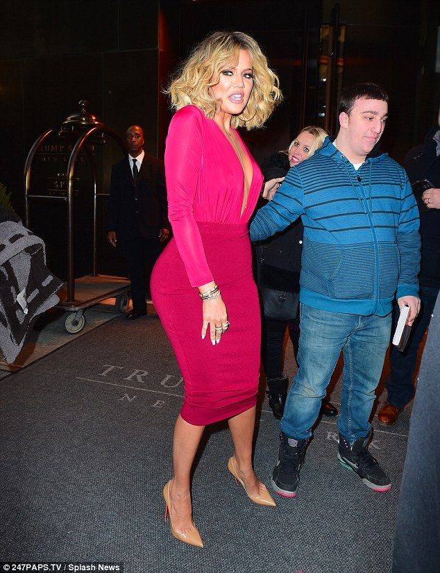 Time for the fans: Khloe was a vision in pink as she grabbed the fans to pose for pictures