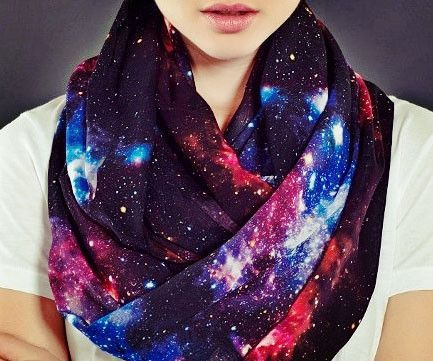 Give your outfit an out of this world touch by accenting it with this galaxy scarf. This infinity loop scarf is made from Chiffon fabric and comes printed with a colorful and vivid image of our majest