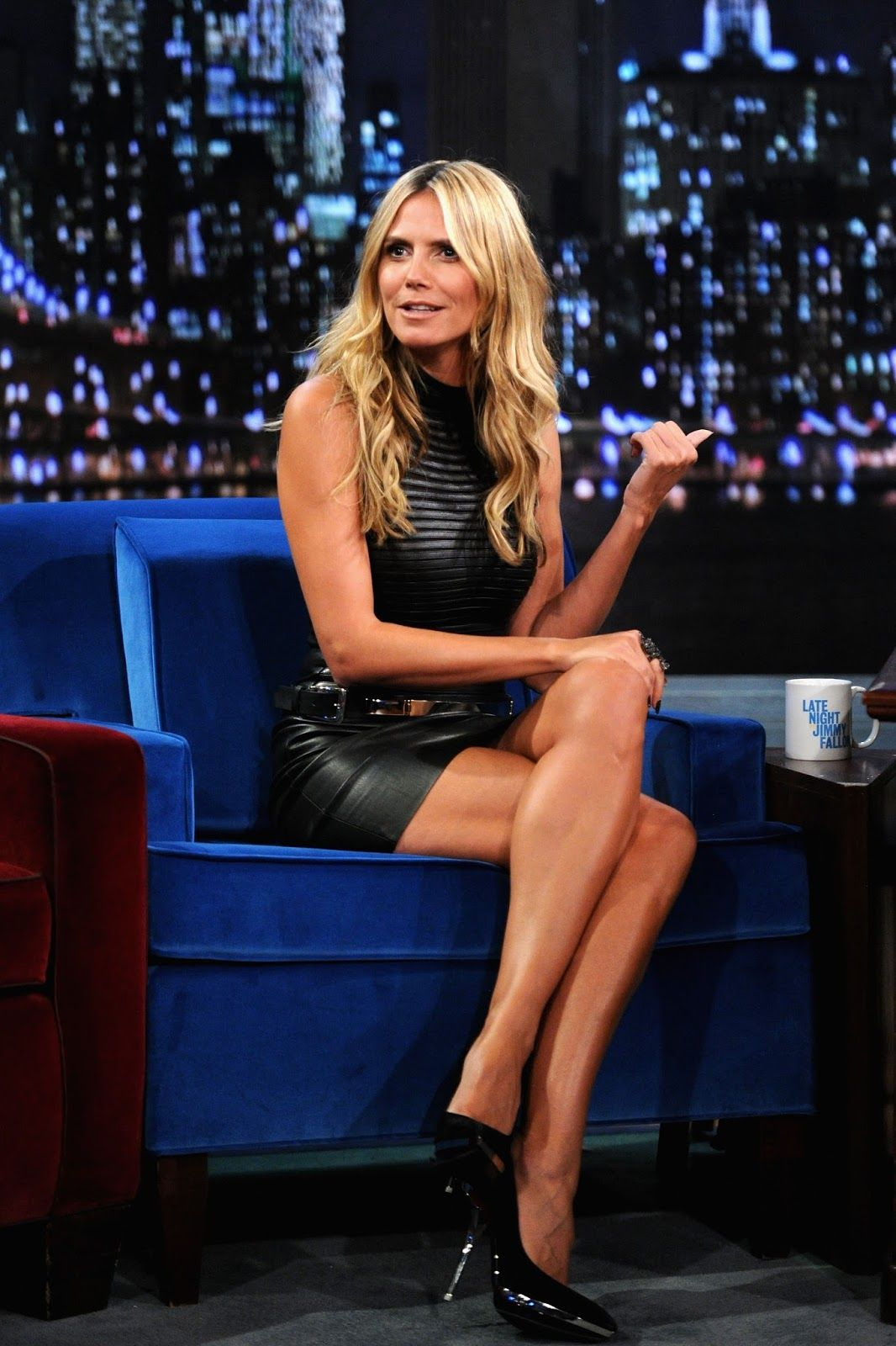 Heidi Klum shows her sexy legs to Jimmy Fallon and his TV audience.