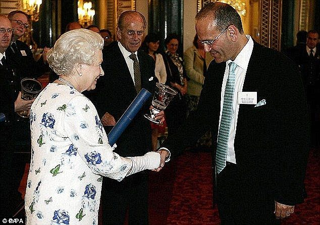 The Queen presents an award for enterprise to Richard, then the Chairman and Co-Founder of...