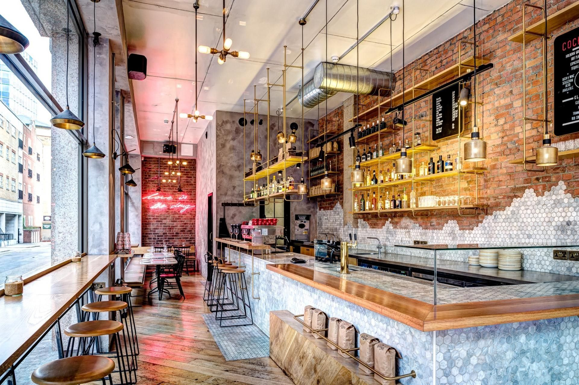 Biosol Design Studio specified the Brass Four Bulb Pendants and ...