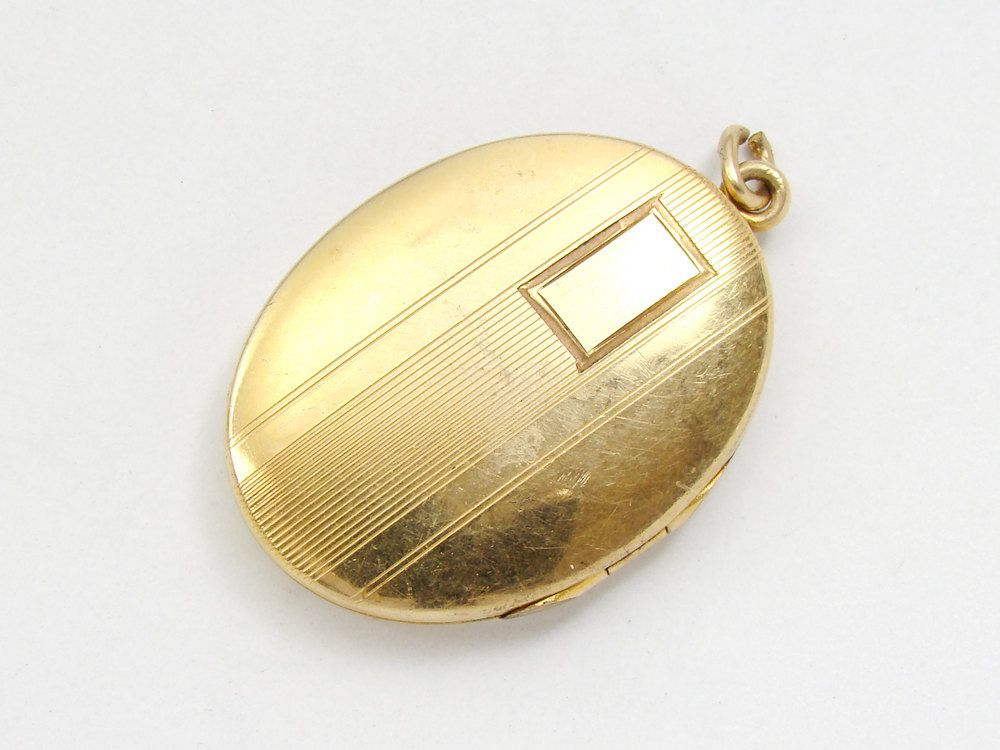 This is a picture of a Victorian oval gold locket. These were very popular during the 1910's. This is an example of everyday jewelry.