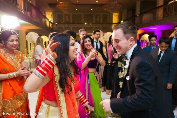 Indian couple dancing at their wedding reception httpswww indian couple dancing at their wedding reception https maharaniweddings junglespirit Images