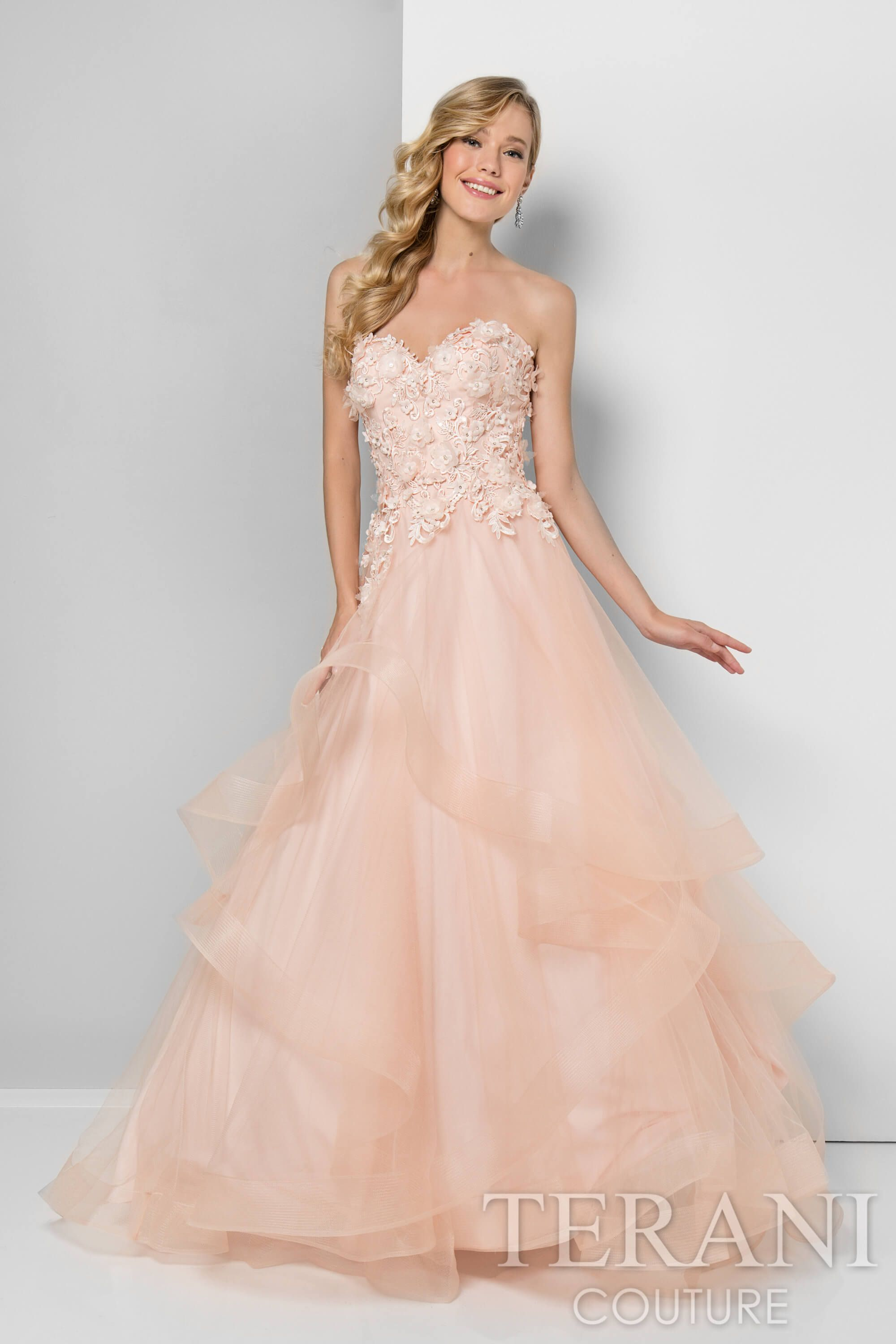 Designer prom dress in a peach cream color featuring organza ...