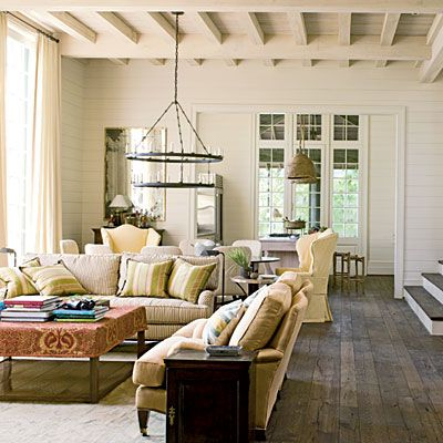 love the beams, weathered wood floors and planked walls