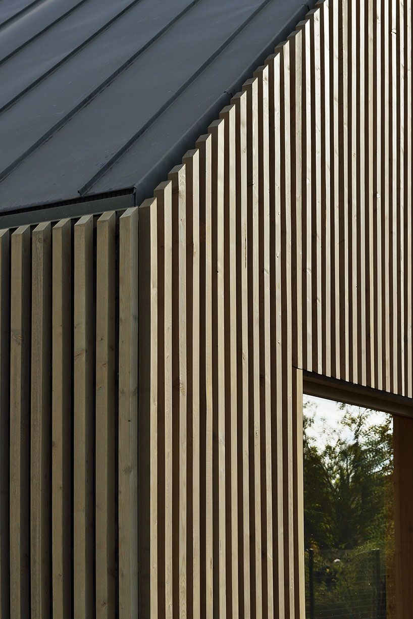 this school in perthes-en-gâtinais comprises multiple gabled wooden volumes